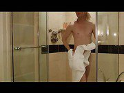sweet blonde shemale is taking a shower and pee