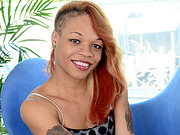 Ebony tgirl Candi Love shows her sweet ethnic tease then hand surfs her cock