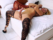 Shemale in stockings jerks her big curved cock!