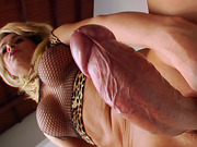 Shemale in stockings plays with her huge cock