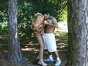 blonde shemale is outdoors blows a big cock