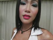 sweet Asian ladyboy is posing with her amazing body