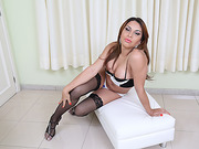 Transbabe Agatha takes off her fishnets to fap her erect cock