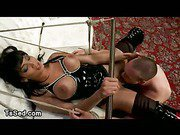 Busty tranny in latex fucks in mouth and ass bdsm guy