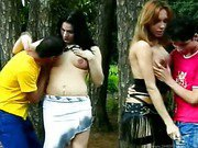 Two trannies in hot sex party outdoors 1