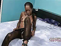 black shemale in fishnets plays her big cock