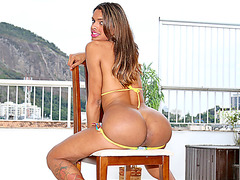 Curvy Latina TS Tayla Leal removes her bikini and jerks off