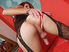 Feisty redhead tgirl masturbates her cock on the bed