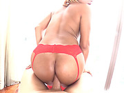Big ass ladyboy devours a huge cock with her mouth and ass