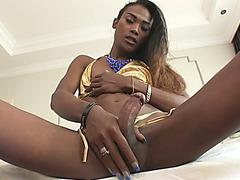 Dark skin ladyboy Jina anal pounded hard while sucking