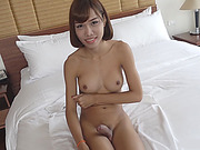 Busty brunette shemale Noey gets her ass banged in bed