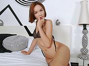 Asian ladyboy Mikki A masturbates her big cock on sofa