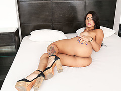 Pretty transbabe Tifanny hooks up to a younger guy and fucked her on bed