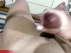 Shegirl with big prick shoots jizz load all over her belly