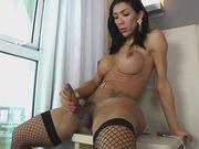 TS Sabrina Suzuki Enjoys Stroking Her Huge Cock