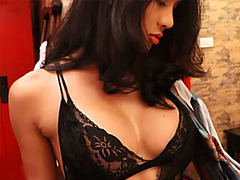 Big fake boobs ladyboy in lingerie gives a blowjob