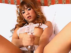 Sexy asian ladyboy having sexy fun with her special toy
