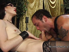 Handcuffed male slave dominated by tranny