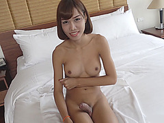 Big tits brunette shemale Noey gets her ass banged in bed