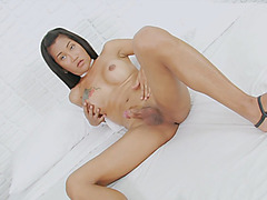 Busty tattooed shemale Ploy shows off her ass and masturbates cock