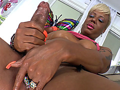 Horny black shemale masturbated in front of a camera