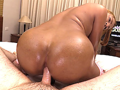 Big ass ladyboy gives a handjob before being barebacked