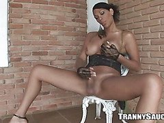 Sexy ebony shemale hottie tugging on her hard cock