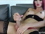 Yummy shemale bombshell Eva Lin teases with her nice tits and thick cock