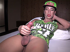 Hip hop ladyboy shemale takes a hard cock in her hands