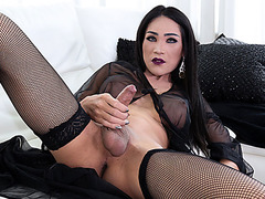 Busty Tgirl Helen C exposes her big butt and jerks her shecock