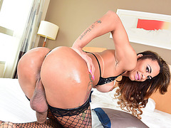 Busty TS Kelly Marques shows her huge shedicks and jerks it