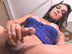 Booby tranny strokes her shaft while sitting on a chair