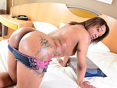 Ebony Tatoo Trans reveals her huge shedick and jerks it and cums