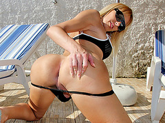 Big boobs blonde shemale babe Gisele Ferrara masturbates by the pool