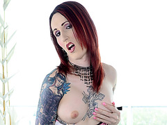 Nasty tranny Brittany St Jordan shows her tattooed body then masturbates