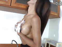 Busty asian shemale hottie Rin jerks off her big and hard cock