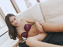 Pretty asian tranny strokes her tiny cock on the couch