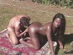 ebony shemale is outdoors fuck doggy style