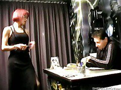 a stunning redhead shemale is feeding a guy with her dick
