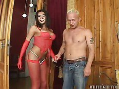 big tit shemale in red stockings is getting sucked
