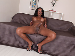 Busty ebony TS fingers her ass and masturbates her shecock