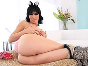TS Kitty Danika Uses a Purple Dildo to Wank her Anus