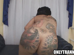 Busty shemale Penelope Jolie tugging on her cock