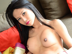 Asian ladyboy Sai in erotic stripping and in solo masturbation