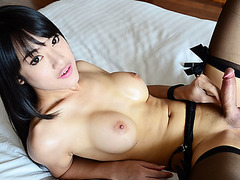 Ladyboy Bee strips her lingerie and she jacks off her oriental dick