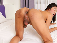 Thai ladyboy Tongta grabs her erect dick and jerks off sensually