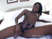 ebony shemale strips and plays her big cock