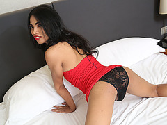 Pretty ladyboy Bell strokes her lovely dick and cum