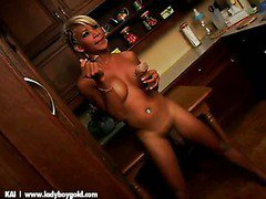 a stunning ladyboy is naked in kitchen