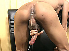Petite exotic ladyboy shows off tiny ass and shoots cumload